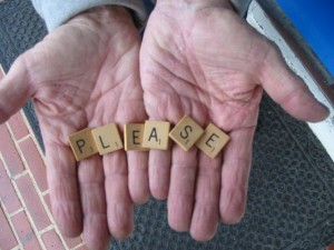 "hands holding Scrabble tiles, spelling ""please"""