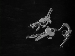black and white photo of two key rings on a desk