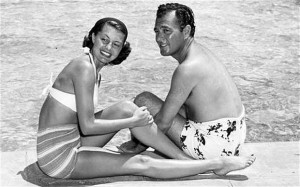 Singer Tony Martin with wife Cyd Charisse pose poolside, unknown date