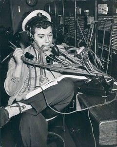 Photo of actor Ezra Stone as Henry Aldrich, at an old-fashioned switchboard, making a mess of multiple lines