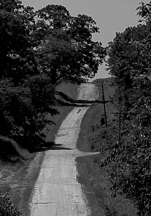 Black And White Photo Of A Country Road